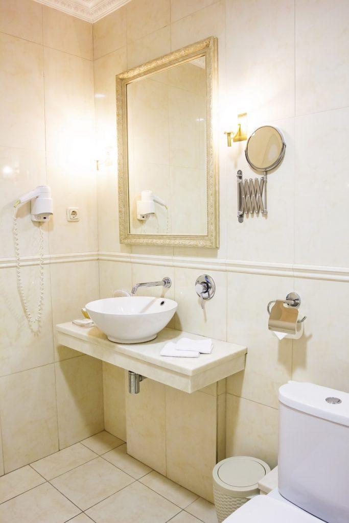Bathroom, sink, toilet in light yellow tones
