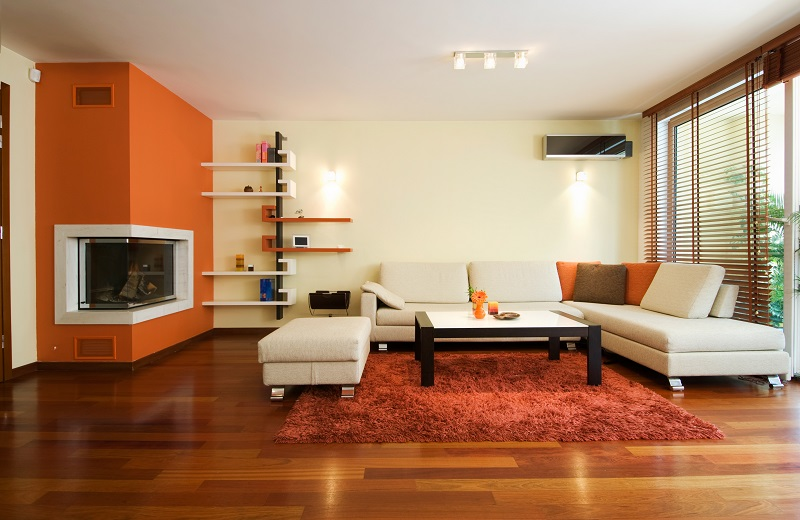 Modern living room apartment in orange and white color combinations