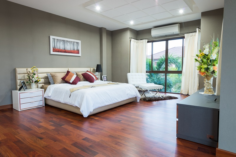 Bedroom with gray walls and white bed