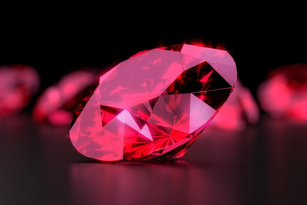 3D rendering of a red diamond on a dark background