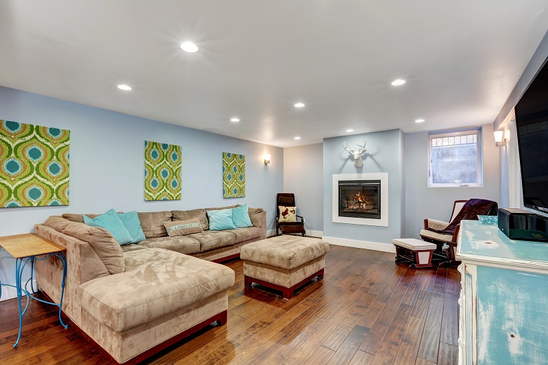 pastel blue basement TV room