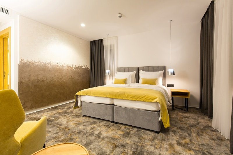 bed with yellow sheet and pillows bed room interior design