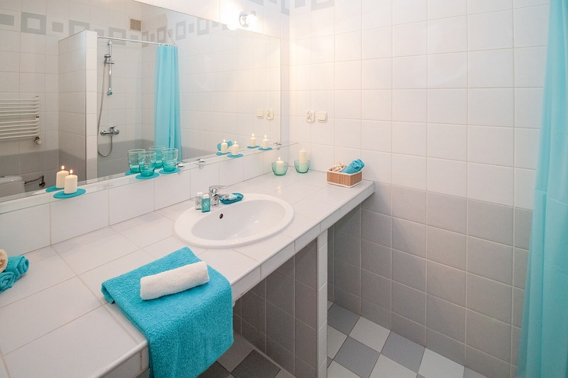 white bathroom with blue towels