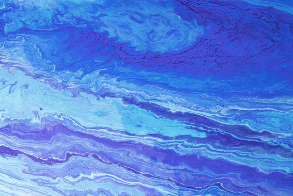 Blue-purple paint waves in different shades