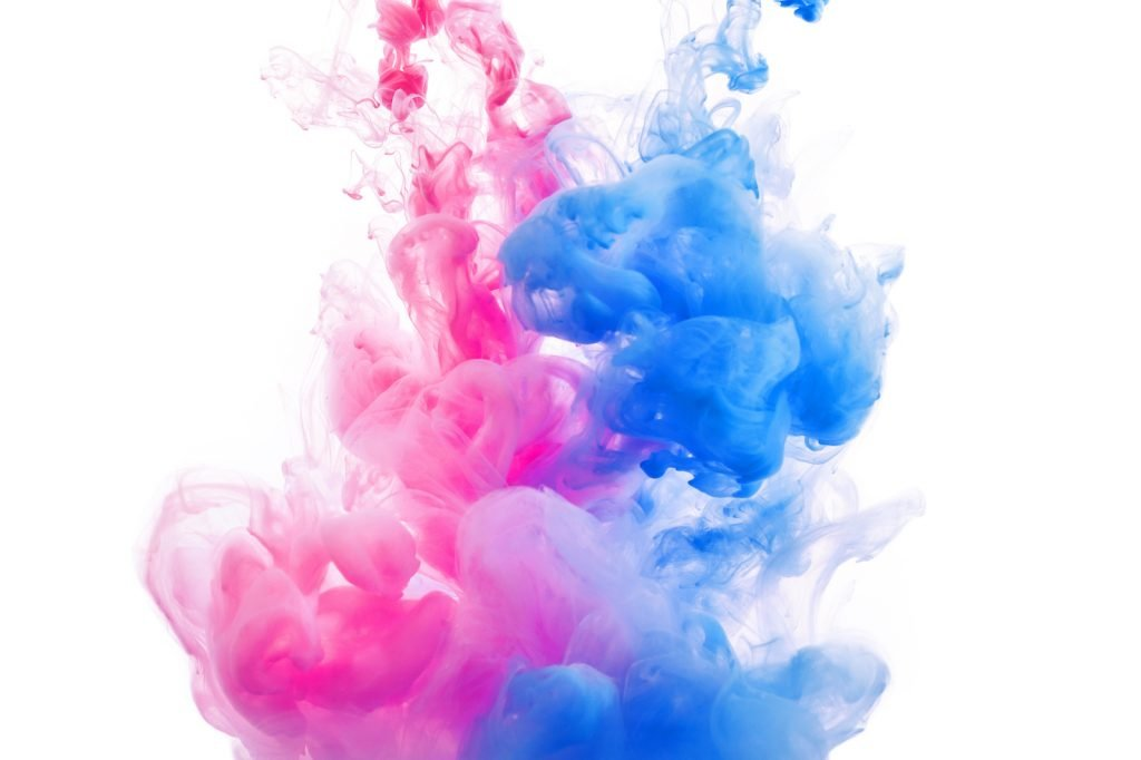 Blue and pink clouds on white background