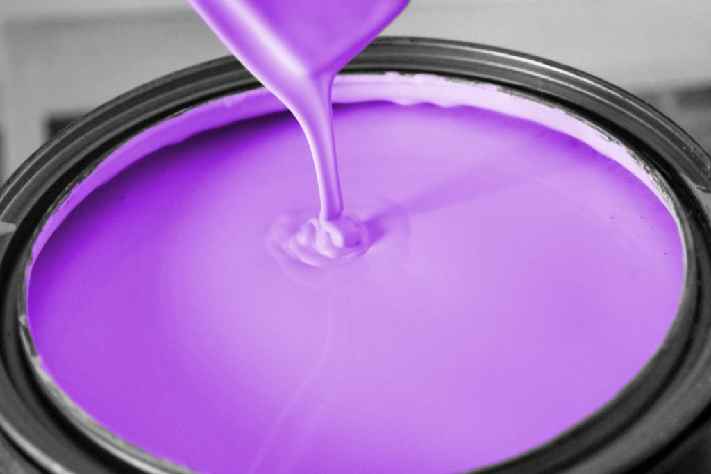 Bucket of purple paint closeup