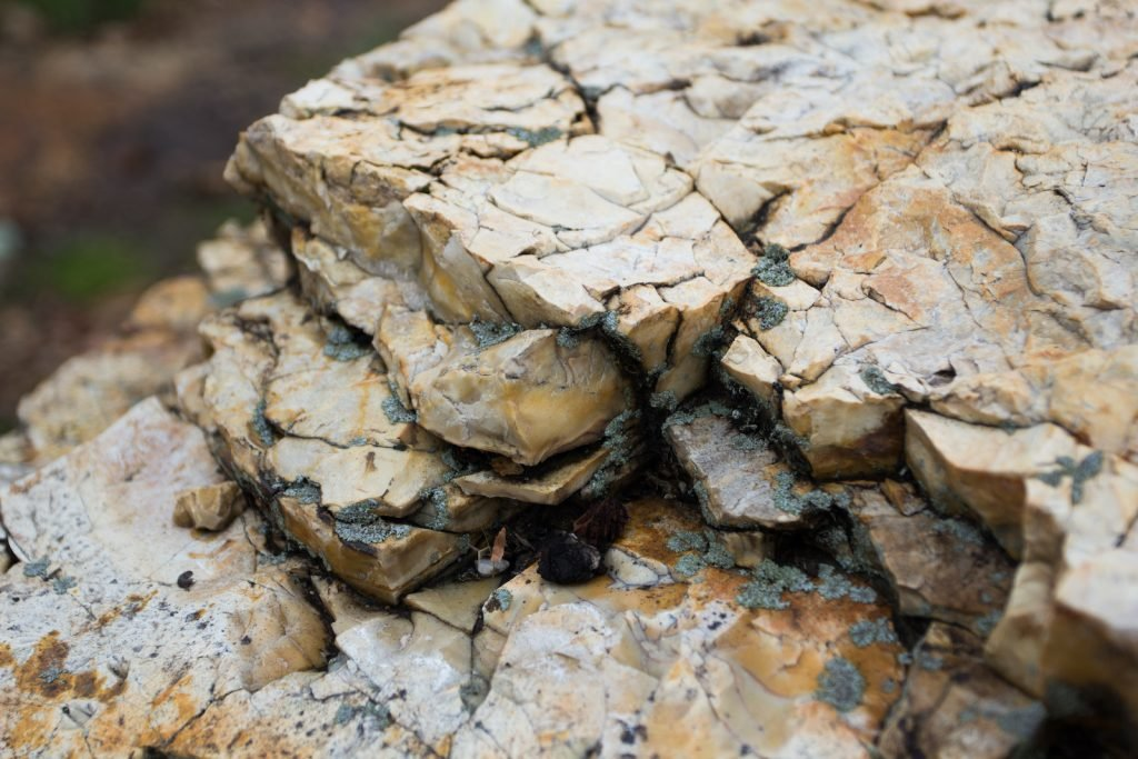 Though chert has a smooth, tight-grained surface, it's actually a type of sedimentary rock.