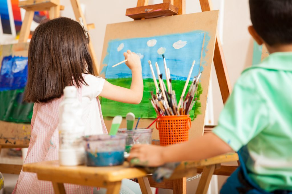 Girl painting a colorful picture