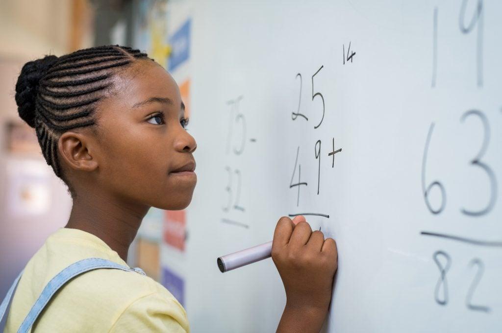 Kid solving math problems