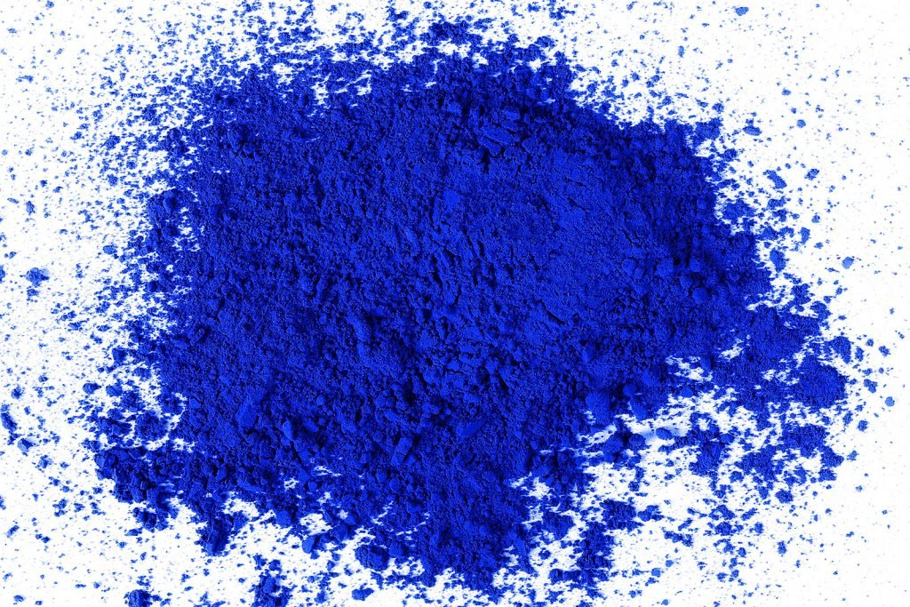 YInMn Blue color pigment on white background