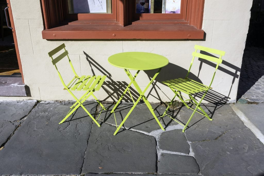 Yellow-green patio furniture outside building