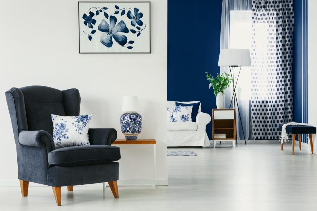 Accent colors in bright living room interior in blue and white colors