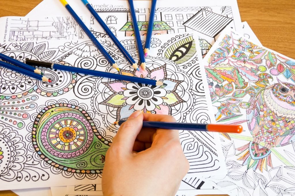 Adult relieving stress with pencils and coloring books