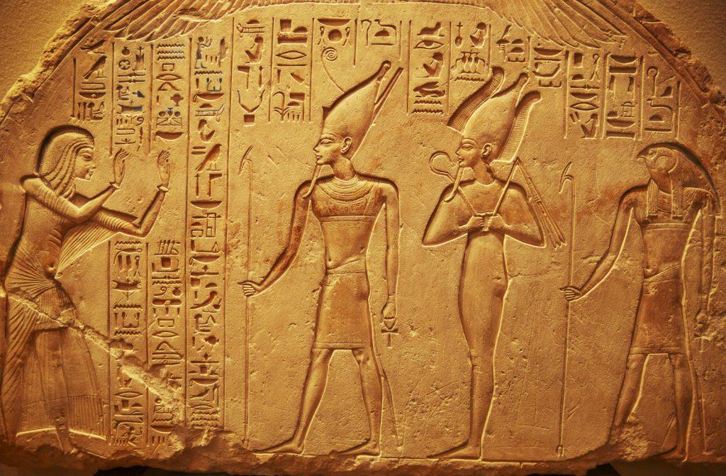 Ancient Egyptian hieroglyphs on stone wall