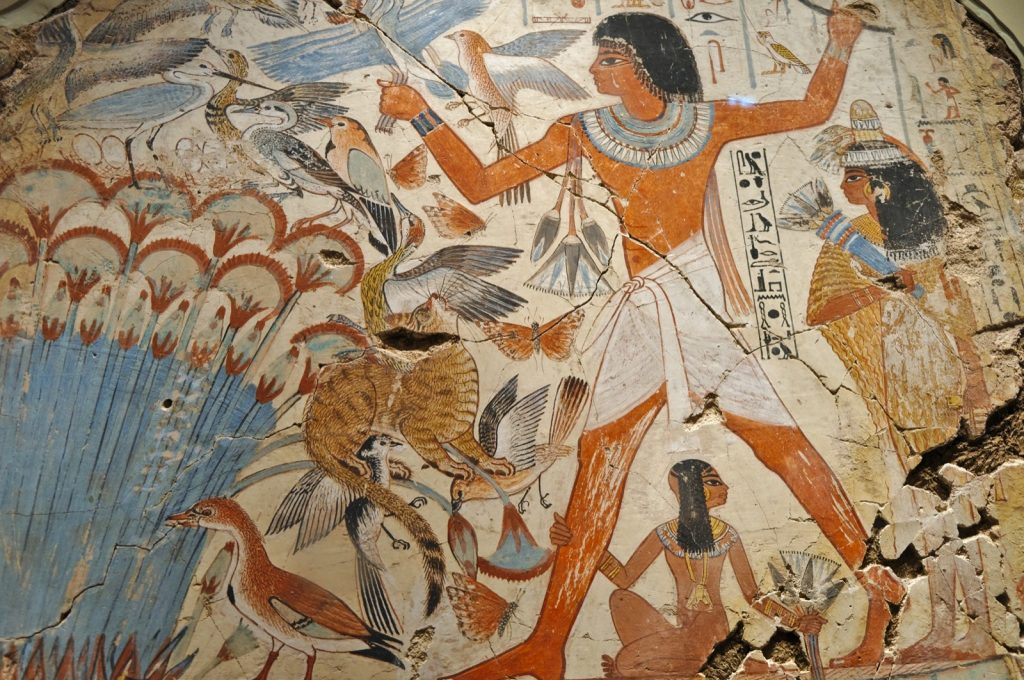 Ancient Egyptian wall painting with orange colors