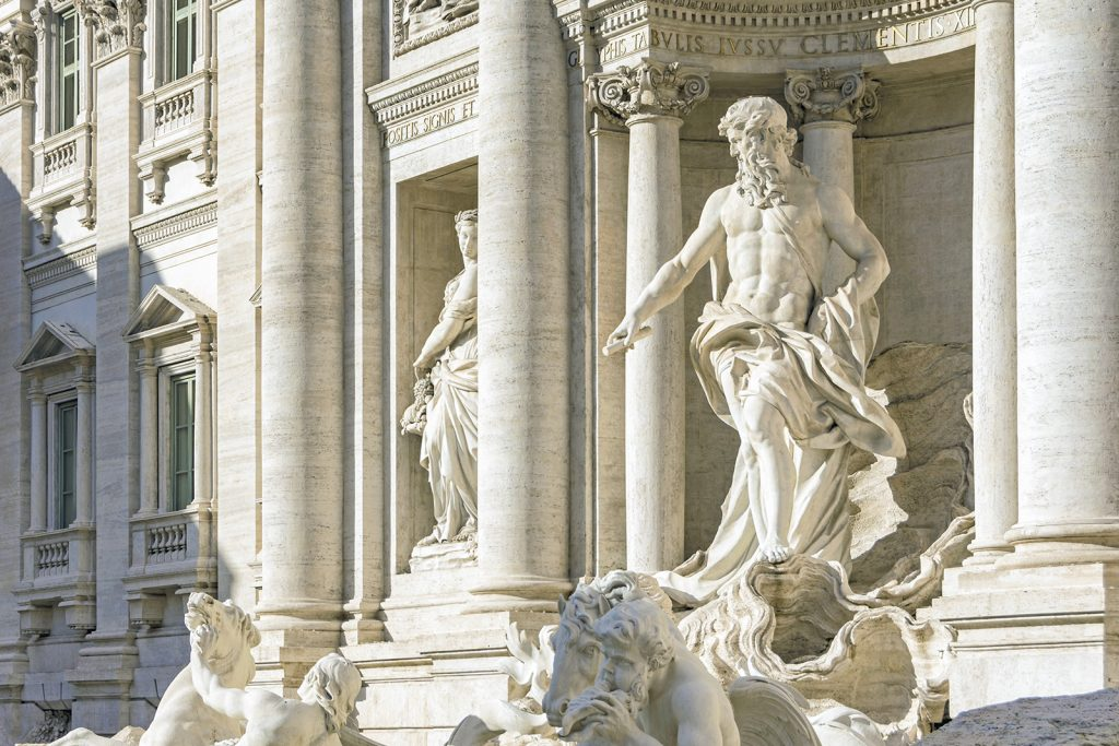 Ancient Fontana di Trevi in Rome with white marble sculptures