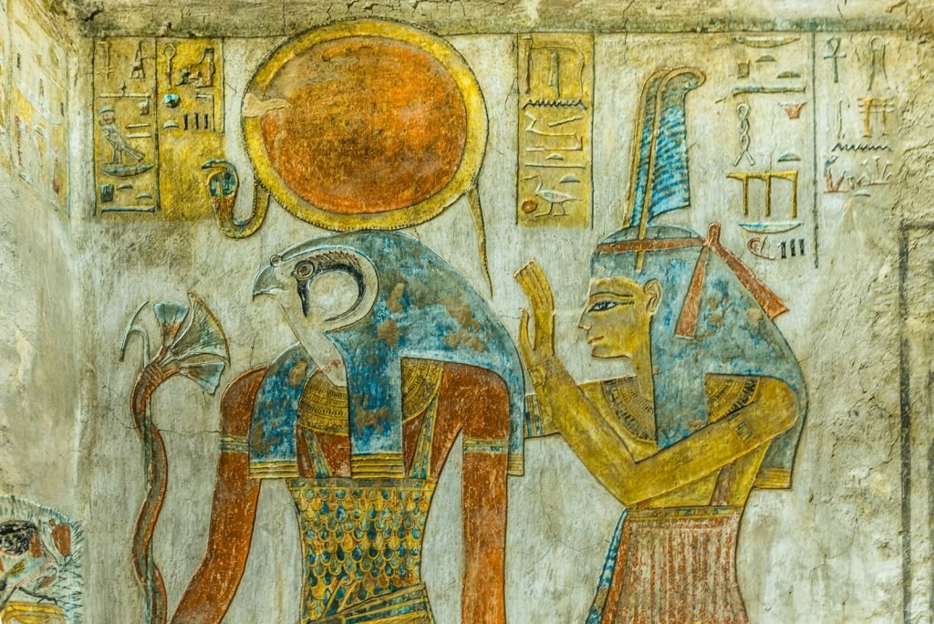 Ancient painting of the Egyptian sun god Ra and goddess Maat in a tomb