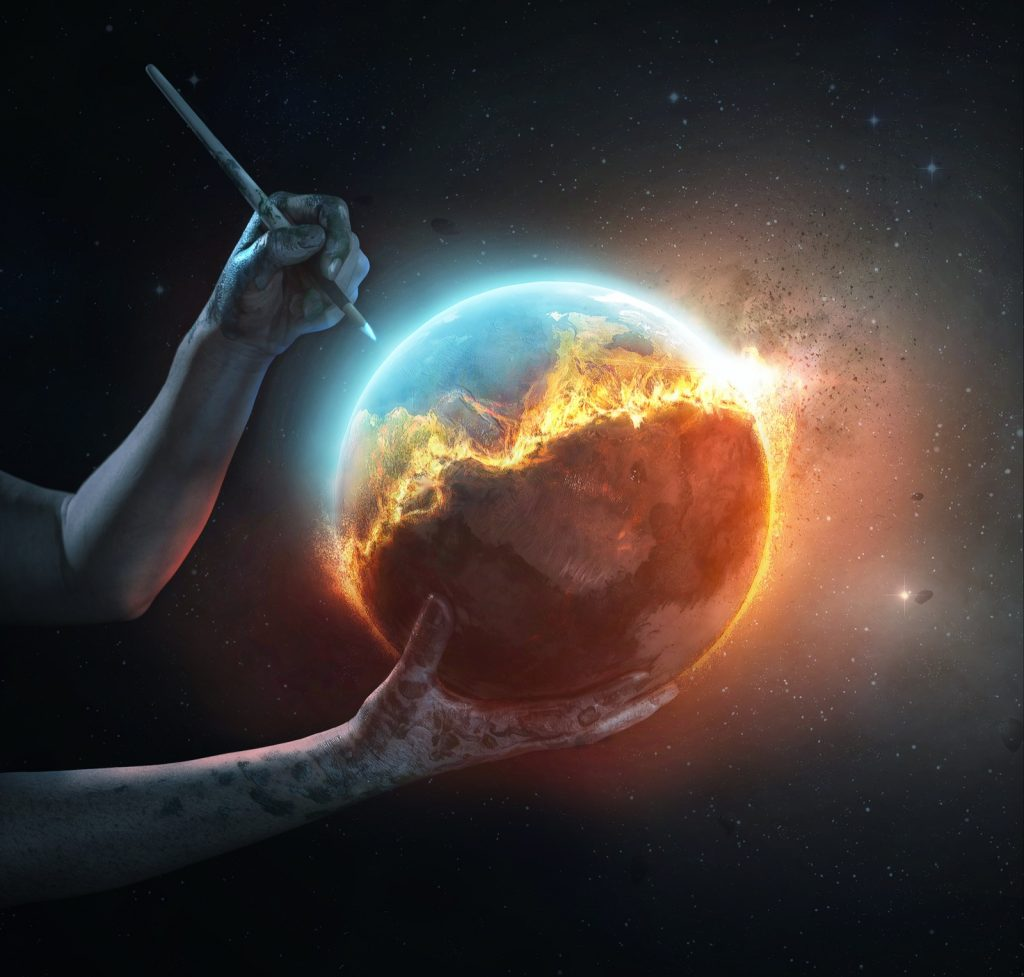 A surreal image of a colorful world on fire being saved by an artists hands