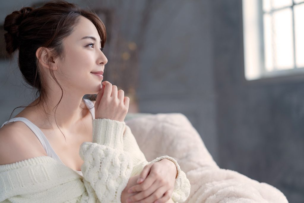 Asian woman in soft white sweater