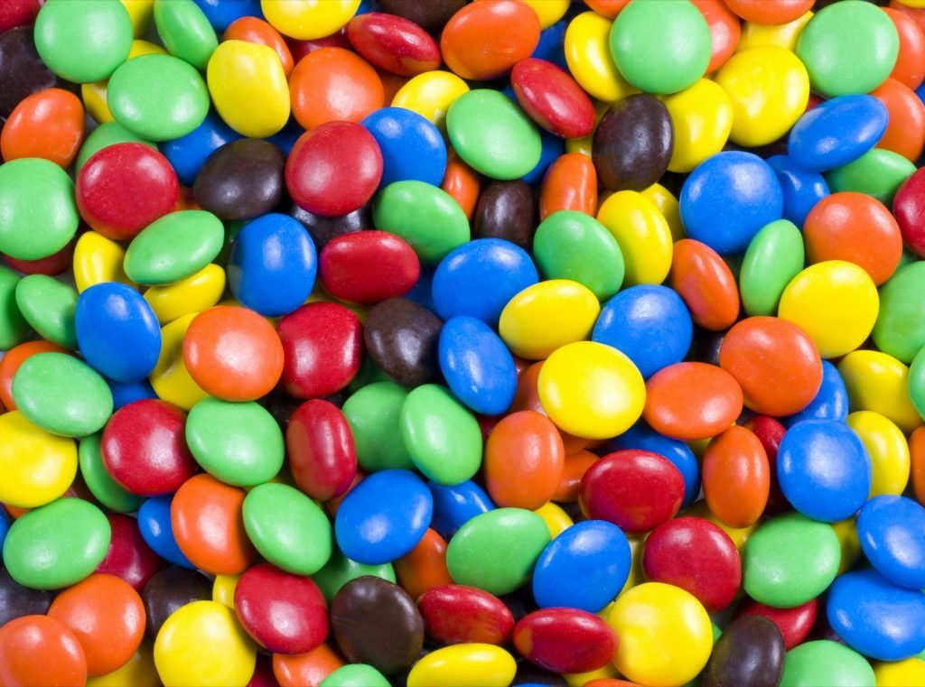 Assortment of colorful chocolate candy that looks like M&Ms