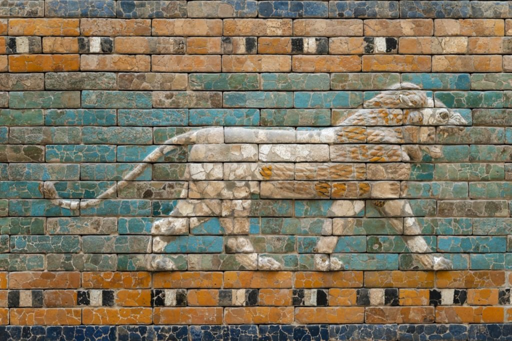 Walking lion relief on green glazed ceramic wall from ancient Babylon Mesopotamia