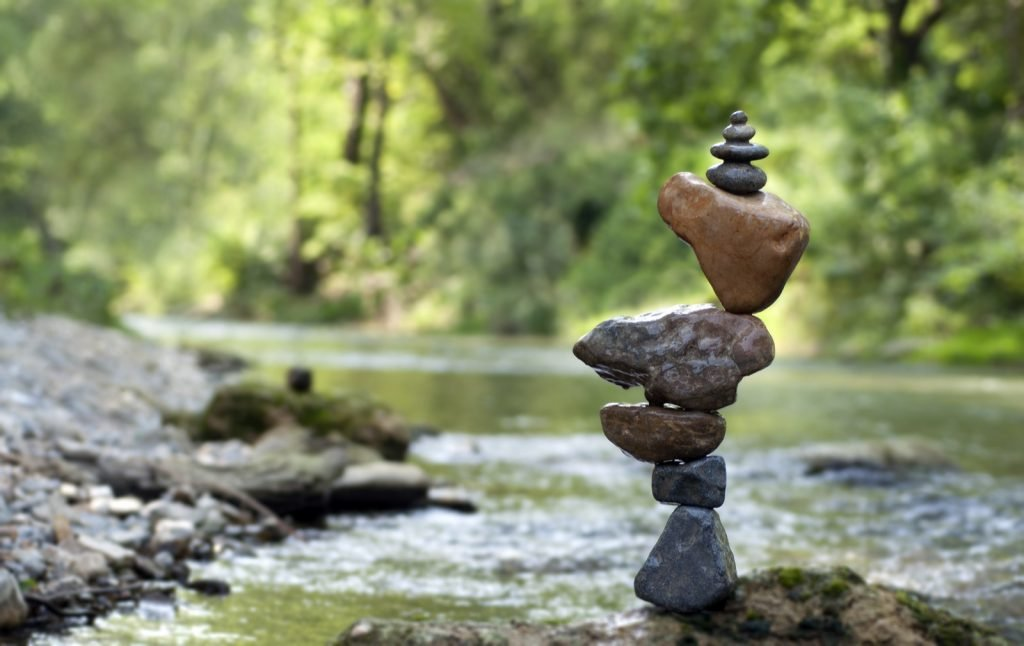 Perfectly balanced stones at the riverside