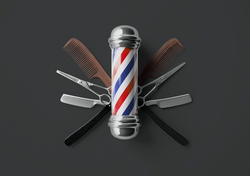 Barbershop logo design with scissor, razor and comb on dark background