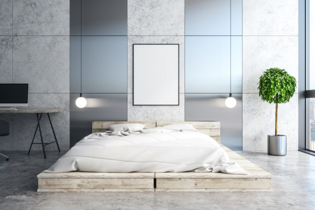 Bright bedroom interior with silver and stone walls and a wooden bed