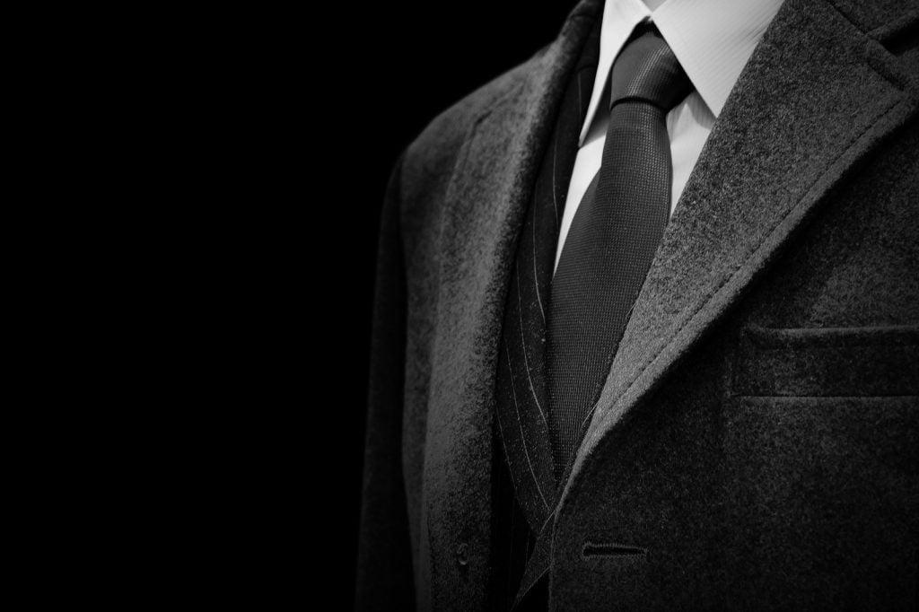 Black tuxedo suit symbolizing formality and high society