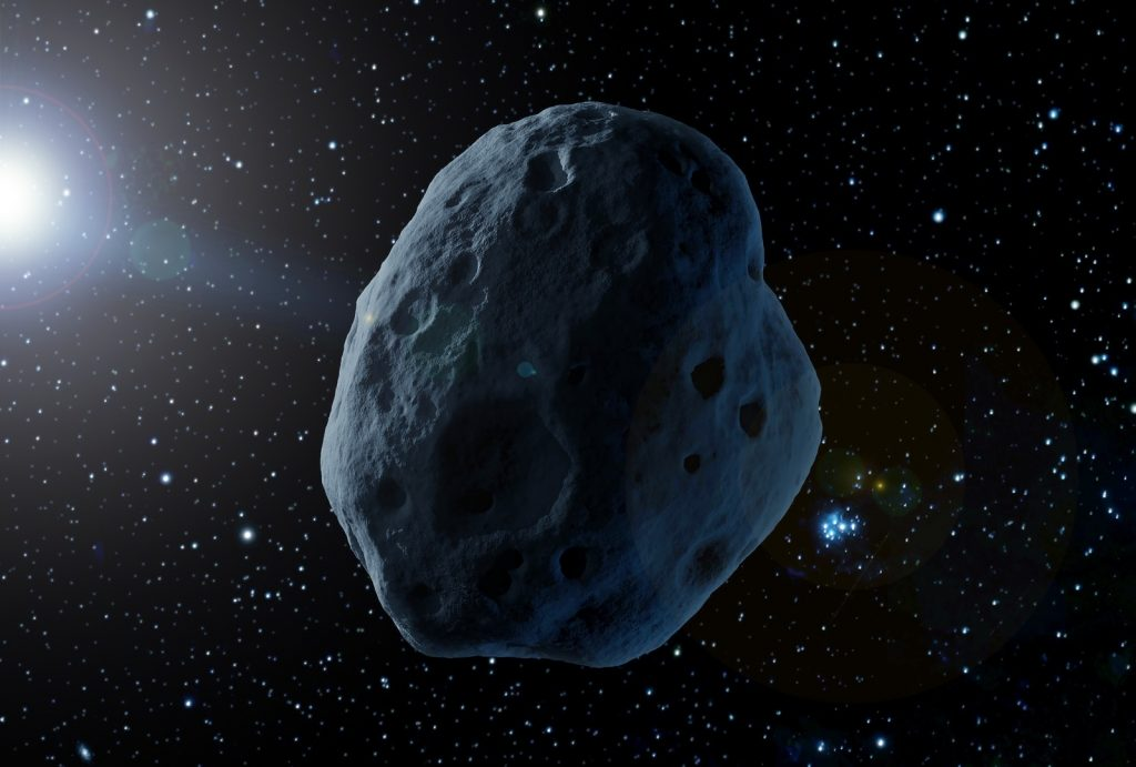 Blue asteroid floating in space