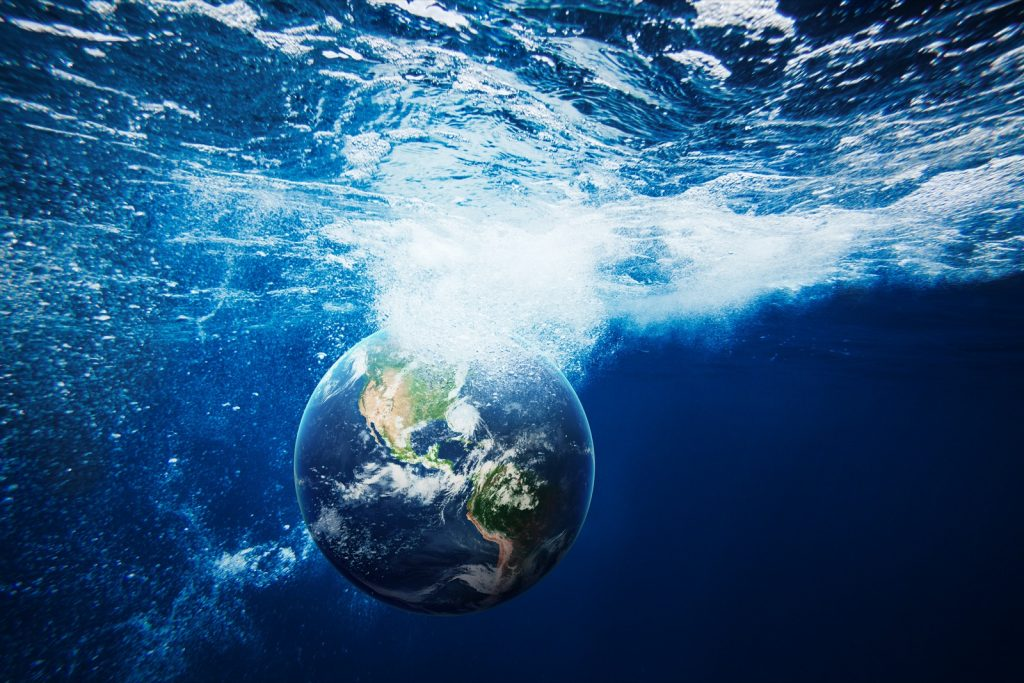 Planet Earth under the surface of clear blue water
