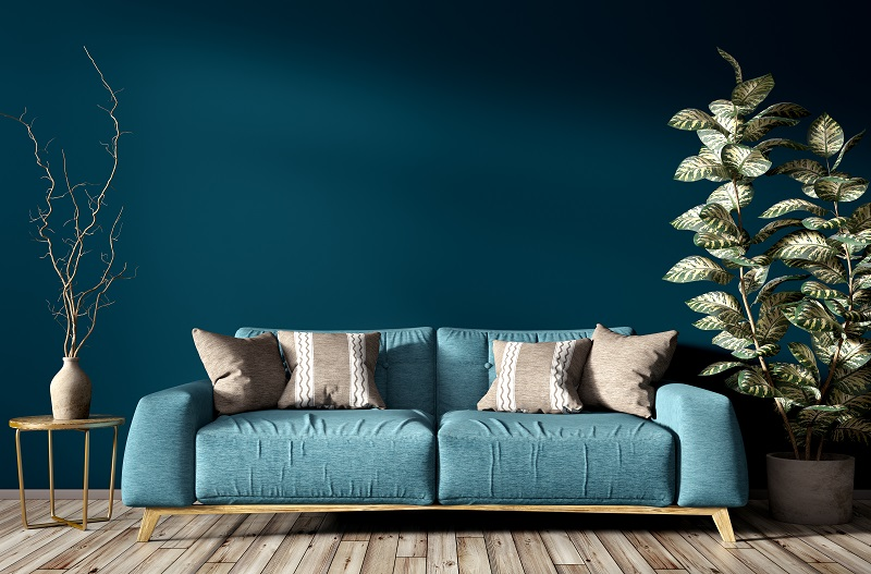 blue sofa in a turquoise painted living room