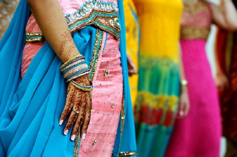 Woman from India with Henna tattoos and blue colored Sari