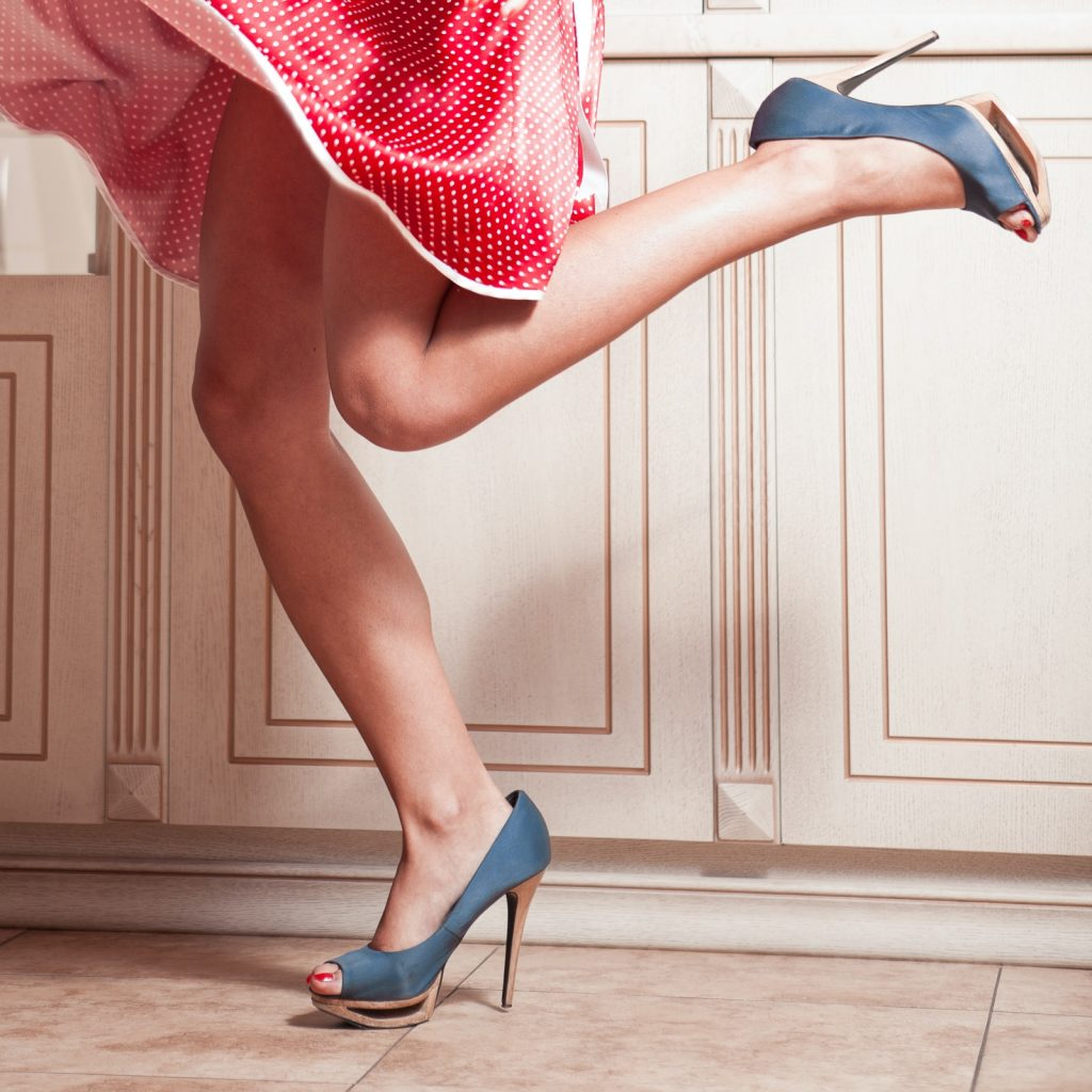 Woman in red dress with blue high heel shoes