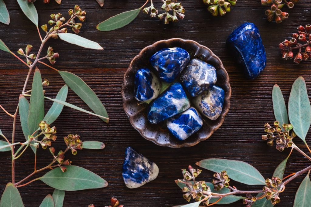 Blue sodalite stones in a ceramic bowl
