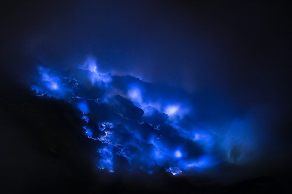 Blue sulfur flames coming from the Kawah Ijen volcano in Indonesia