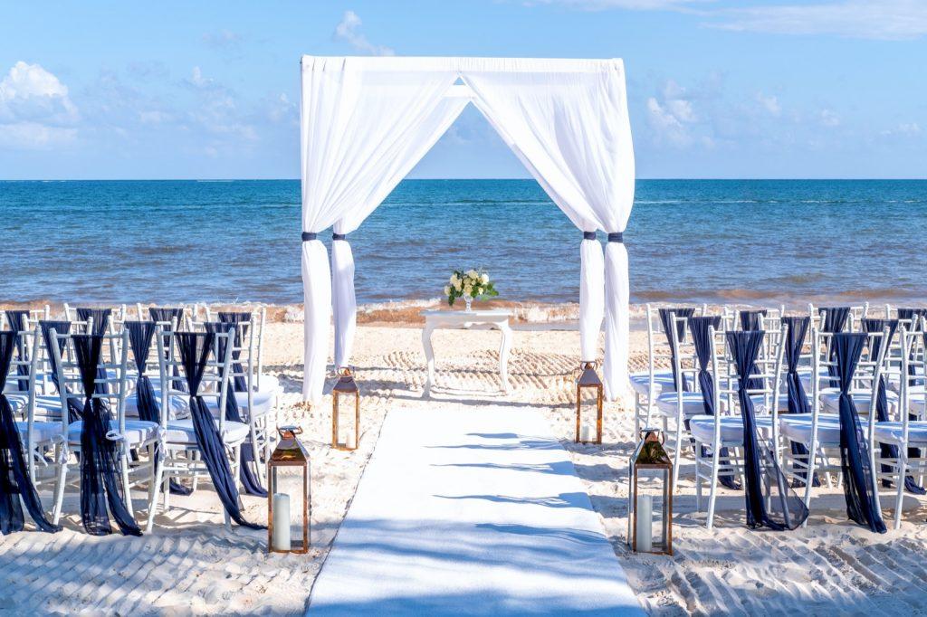 Blue themed wedding setup at white sandy beach