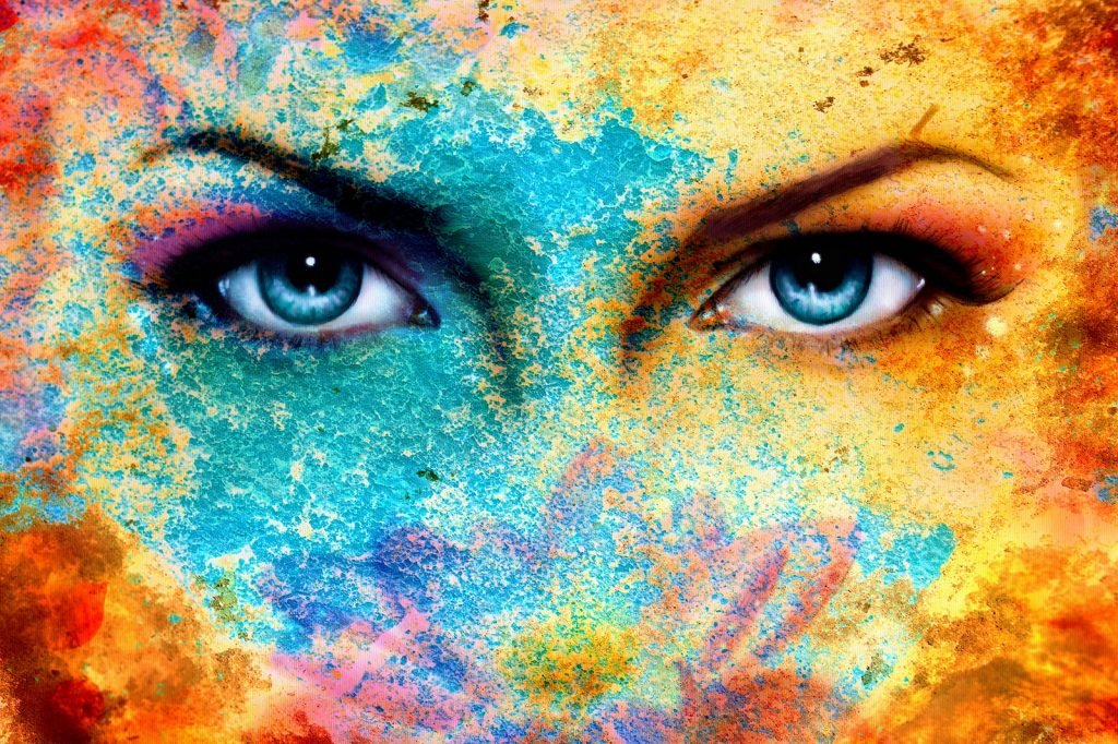 Blue women eyes and a colorful face