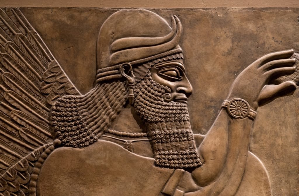 Brown ancient Mesopotamian relief of Assyrian god