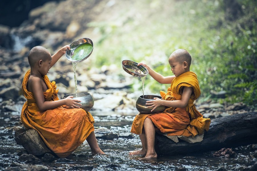 Young buddhist monks in yellow-orange robes