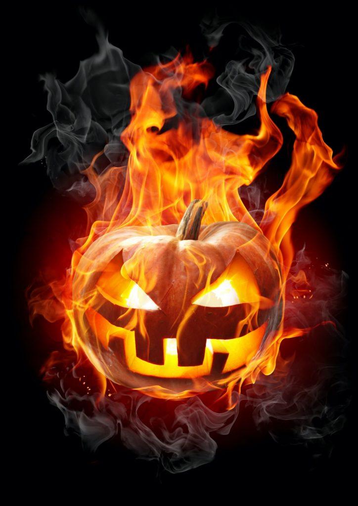 Burning carved halloween pumpkin on a dark background