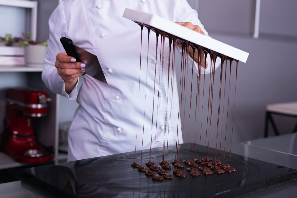 Candy expert at work making chocolate sweets