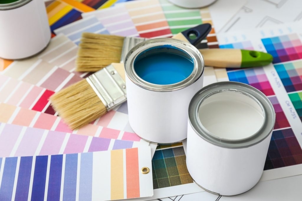 Cans of paint with brushes and palette samples