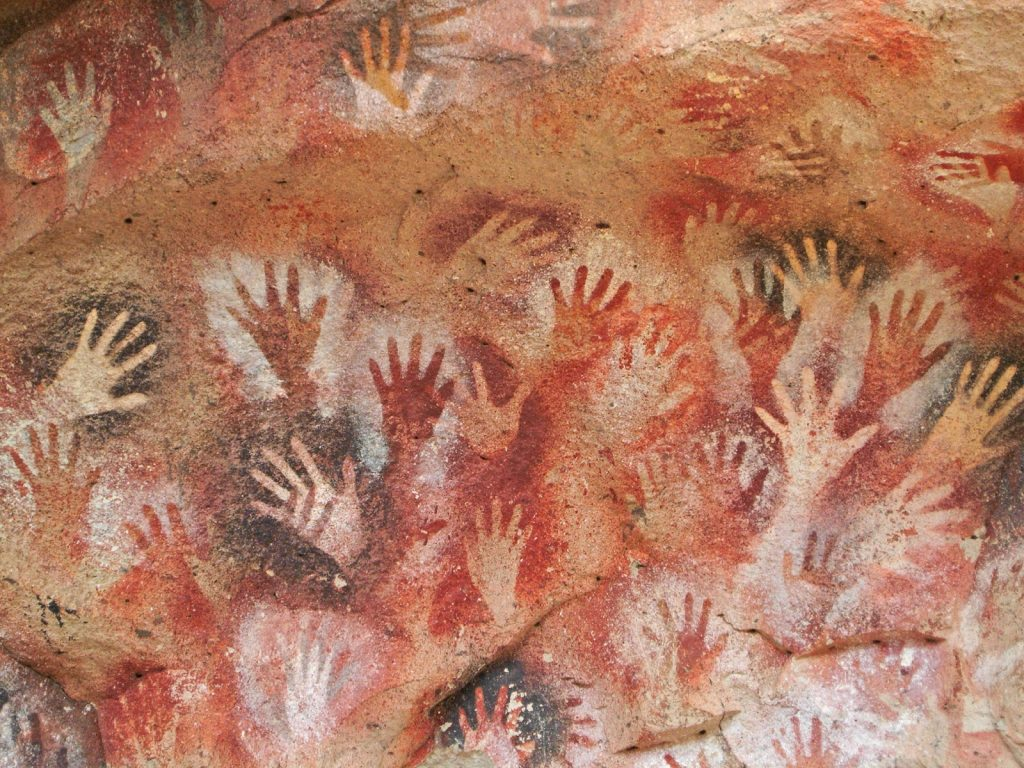 Cave of the Hands rock paintings with red ochre and carbon black colors
