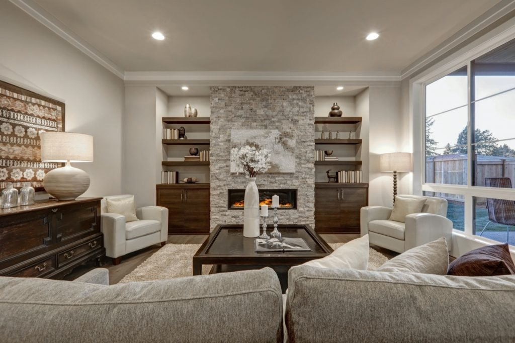 Chic living room interior in gray and brown colors