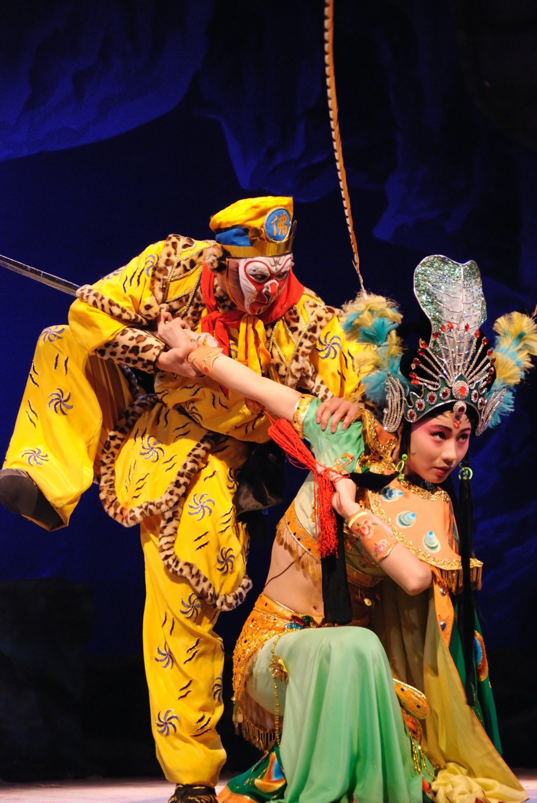 Chinese opera fight between the Monkey King and Princess Iron Fan in colorful costumes