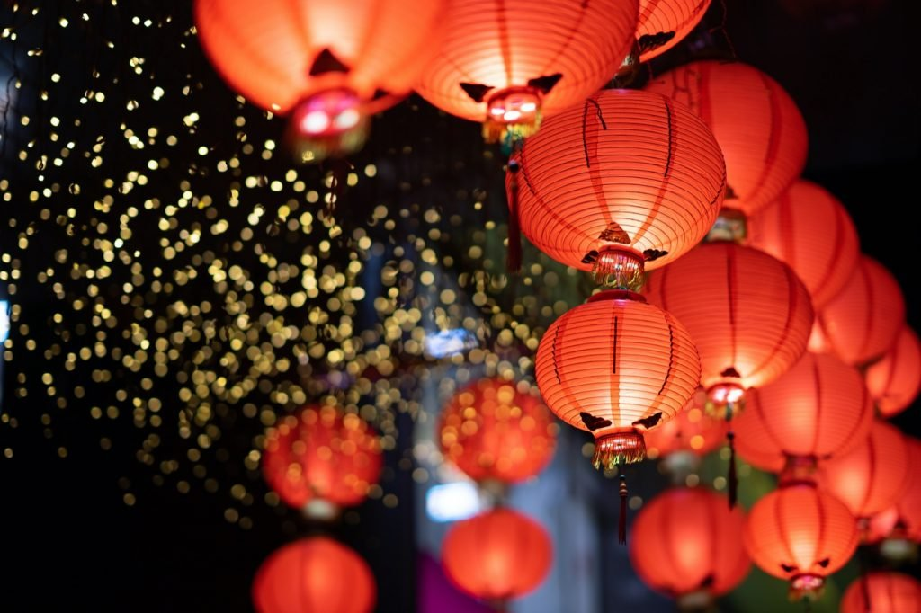 Chinese red lanterns and golden light in the night of Chinese New Year of happiness