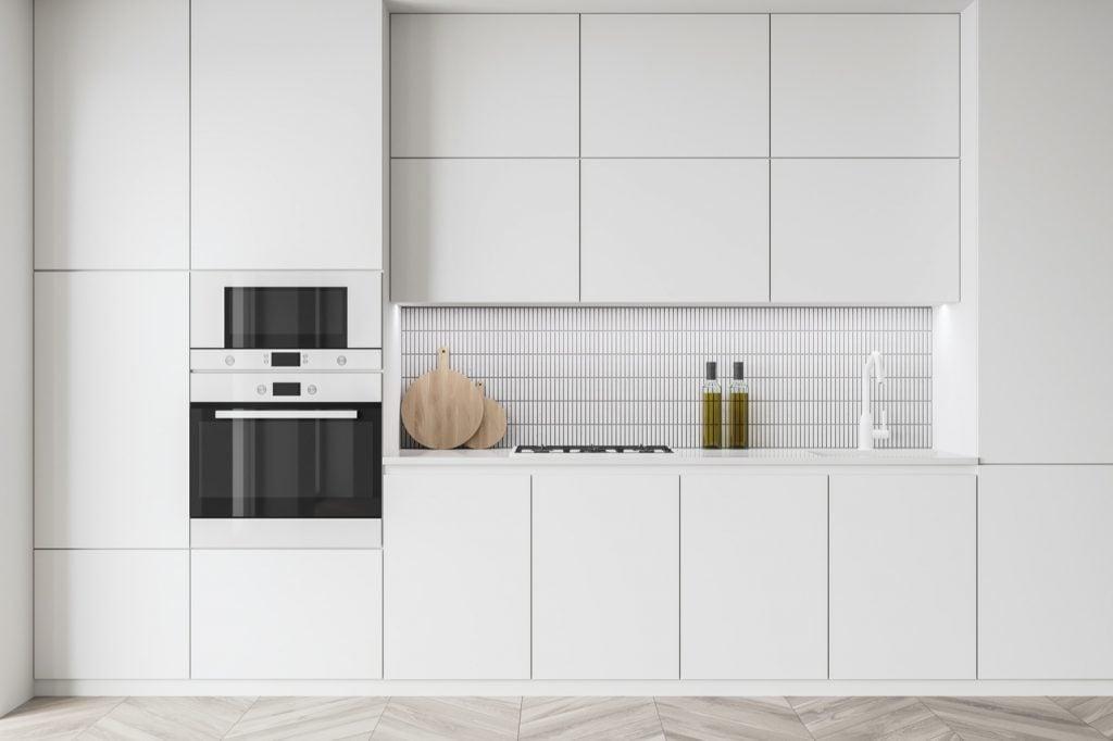 Clean light modern kitchen with ice white appliances