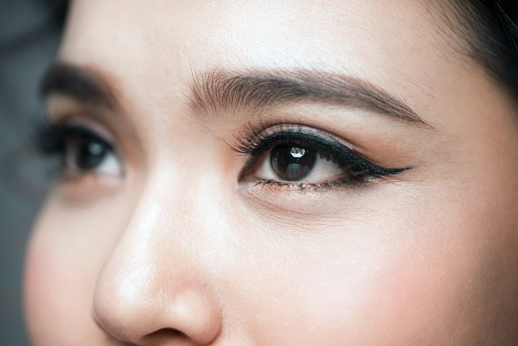 Close-up of Asian woman with very dark brown almost black eyes