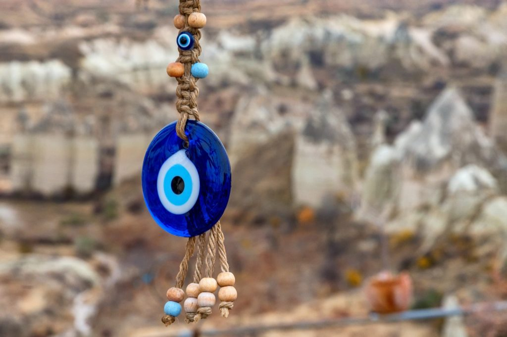 Close up of blue Nazar eye-shaped bead or amulet used to ward off evil and bring good luck in Pakistan